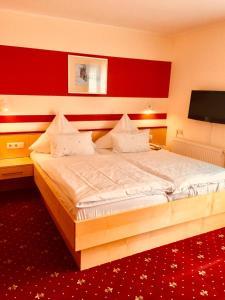 Ein Bett oder Betten in einem Zimmer der Unterkunft Landhotel am Wenzelbach