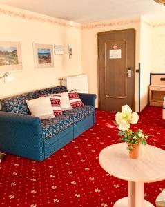 Ein Sitzbereich in der Unterkunft Landhotel am Wenzelbach