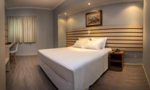 Cama ou camas em um quarto em Hotel KK