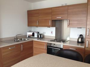 A kitchen or kitchenette at Suite 16 Glasgow