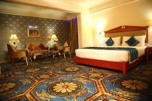 Cama o camas de una habitación en Ramada Amritsar