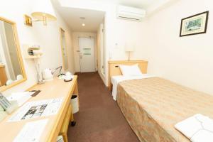 사가 이다이마에 그린 호텔 객실 침대