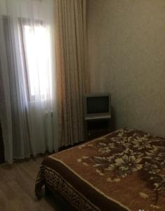 Кровать или кровати в номере Гостевой Дом Сальма