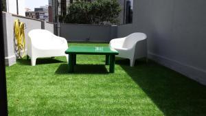 Um jardim no exterior de Hotel 3K Barcelona