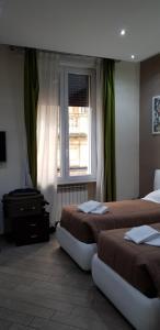 Letto o letti in una camera di Mia Suites