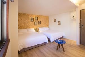 承億輕旅-台南館房間的床