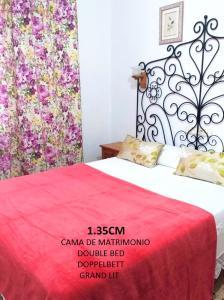 Ein Bett oder Betten in einem Zimmer der Unterkunft Pensión Los Volcanes