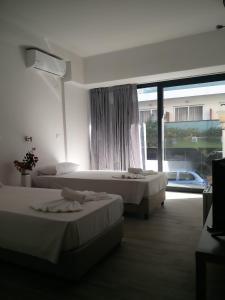 Ένα ή περισσότερα κρεβάτια σε δωμάτιο στο New York Hotel