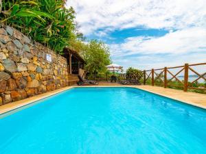 The swimming pool at or near Pousada Perequê