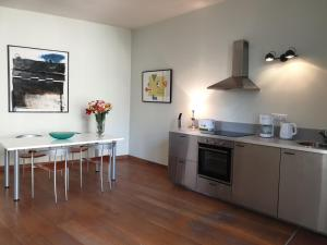 A kitchen or kitchenette at The Art Residence Maastricht