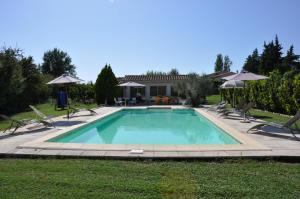 The swimming pool at or near Mas Clement - Chambre et table d'hôtes
