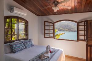 Cama ou camas em um quarto em Pousada Toca do Mar