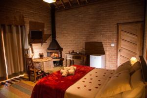 Cama ou camas em um quarto em Chalés Alto dos Pires