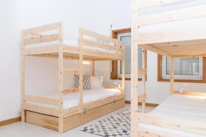A bunk bed or bunk beds in a room at Aguçadoura Guest House