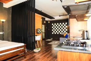 A kitchen or kitchenette at Eden Studio Apartment
