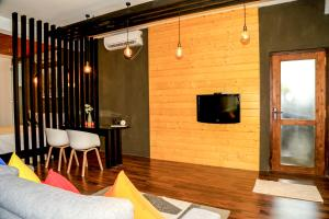 A television and/or entertainment center at Eden Studio Apartment