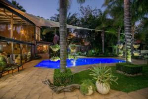 The swimming pool at or near Sunrock Guesthouse