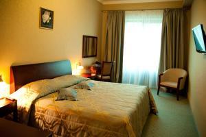 Кровать или кровати в номере Пансионат Плаза Ессентуки