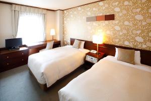 A bed or beds in a room at Hotel Fujita Nara