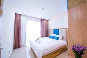 Кровать или кровати в номере Sincero Hotel & Apartment