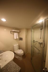 Een badkamer bij Sunshine Hotel & Residences