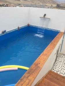 The swimming pool at or close to Departamentos Playa San Bartolo