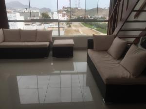 A seating area at Departamentos Playa San Bartolo