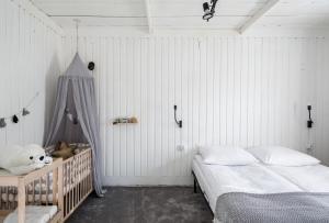 Łóżko lub łóżka w pokoju w obiekcie Local 21A