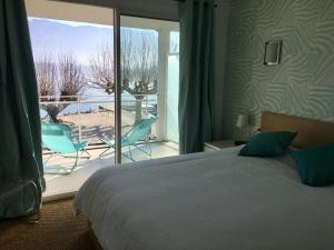 Un ou plusieurs lits dans un hébergement de l'établissement Les Suites du Port