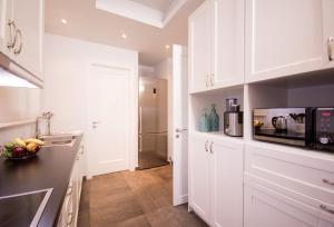 Kuchyň nebo kuchyňský kout v ubytování Bluscapes Home