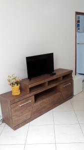 A television and/or entertainment centre at Apartamento Orquídea