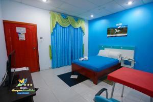 Кровать или кровати в номере Hotel Marques Amazonico
