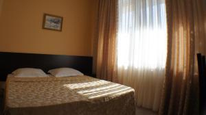 Кровать или кровати в номере Олеся Лоо