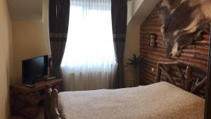 A bed or beds in a room at Hotel Budmo