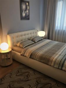 Кровать или кровати в номере Apartment Tamogenaya Akademia 24