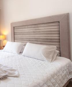 Ένα ή περισσότερα κρεβάτια σε δωμάτιο στο Maistros Village