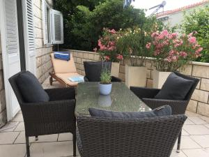 A patio or other outdoor area at Seafront Garden Apartments Lumbarda