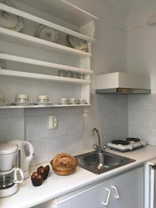 A kitchen or kitchenette at Stefano Apartments