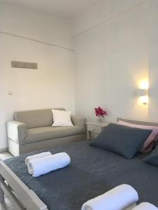 A bed or beds in a room at Stefano Apartments