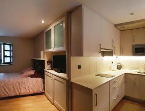 Una cocina o zona de cocina en Apartamentos Villa Cudillero