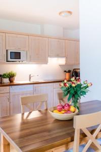 A kitchen or kitchenette at Stranachwirt Apartments