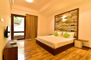 A bed or beds in a room at Hiriketiya Beach Resort