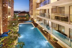 A view of the pool at Harper Kuta Hotel by ASTON or nearby