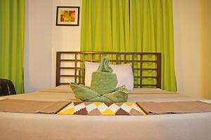 A bed or beds in a room at Coron Hilltop View Resort