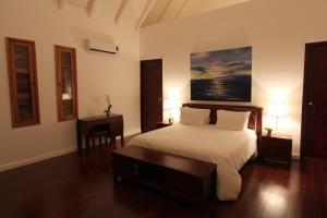 A bed or beds in a room at Playa Venao Hotel Resort