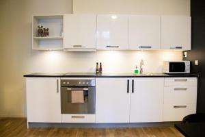 Cuisine ou kitchenette dans l'établissement Forenom Serviced Apartments Oslo Royal Park