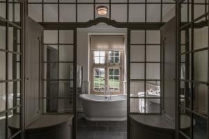 A bathroom at Tylney Hall Hotel
