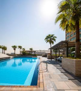 The swimming pool at or near Swissôtel Living Al Ghurair