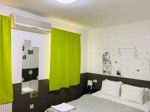 Ein Bett oder Betten in einem Zimmer der Unterkunft Macvanska Guest House