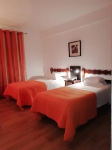 Кровать или кровати в номере Hotel Brasa